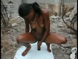 Hot Amateur Ebony Bottling Her Punny in Nature