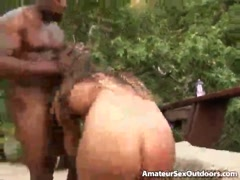 Awesome brunette amateur nymphet Rita Faltoyano gives oral sex to a black stud outdoors