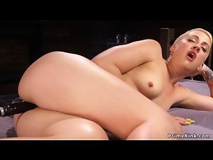 Blonde in bed takes machine in cunt and ass