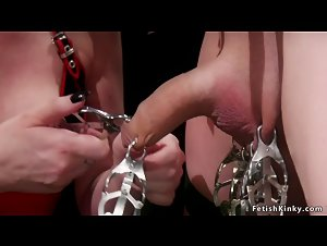 Domme slut clamps slave bound to St Andrews Cross