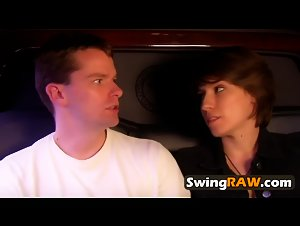 Swinger couples enter orgy.