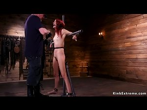 Skinny redhead tormented in device bondage